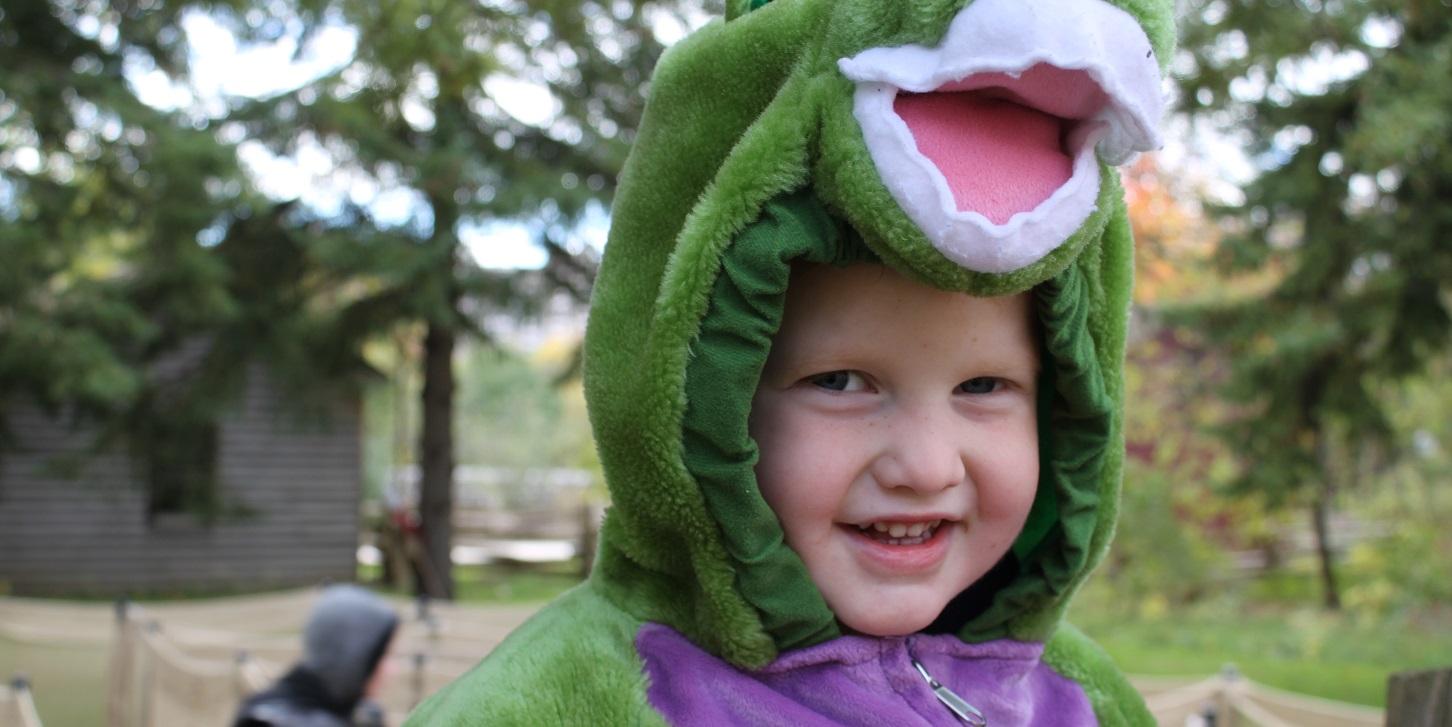 child in costume enjoys a Halloween tour of Black Creek Pioneer Village