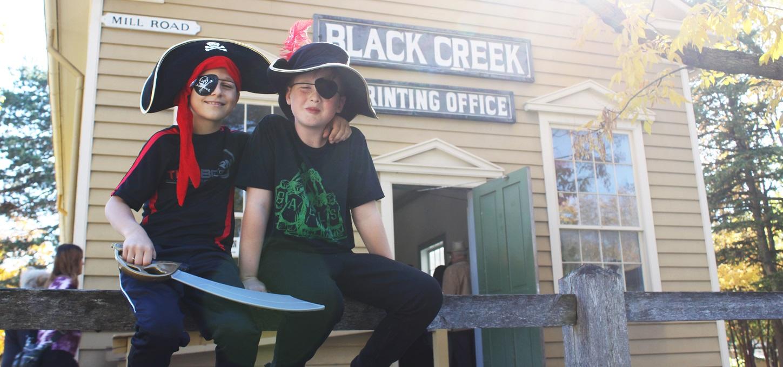 children in costume enjoy a Halloween tour of Black Creek Pioneer Village