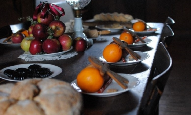 a table is laden with Victorian Christmas treats at Black Creek Pioneer Village