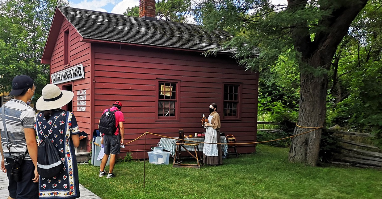 visitors enjoy a self guided tour of Black Creek Pioneer Village