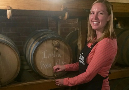 apprentice with casks at Black Creek Historic Brewery