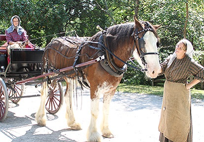 historical interpreter with horse at Black Creek Pioneer Village
