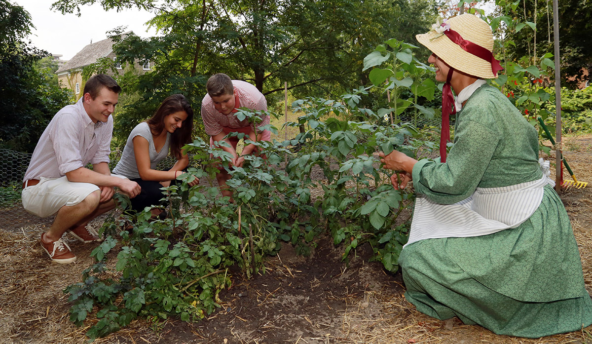 High school group learns about gardening on a field trip to Black Creek Pioneer Village
