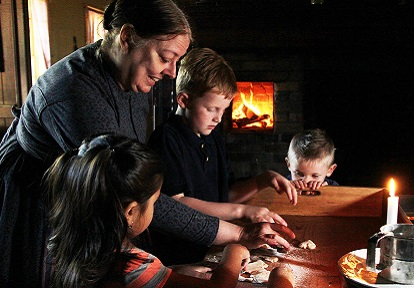 Black Creek Pioneer Village interpreter presents a baking demonstration for school children