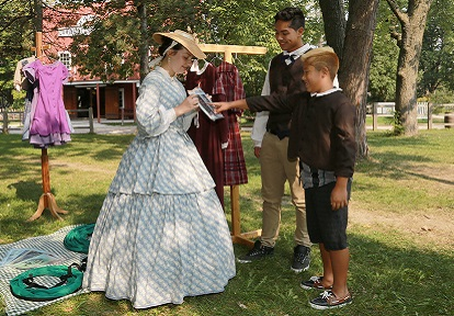 students try on pioneer clothes at Black Creek Pioneer Village