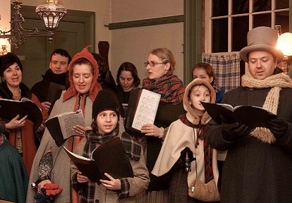 Carolers perform during Christmas by Lamplight at Black Creek Pioneer Village