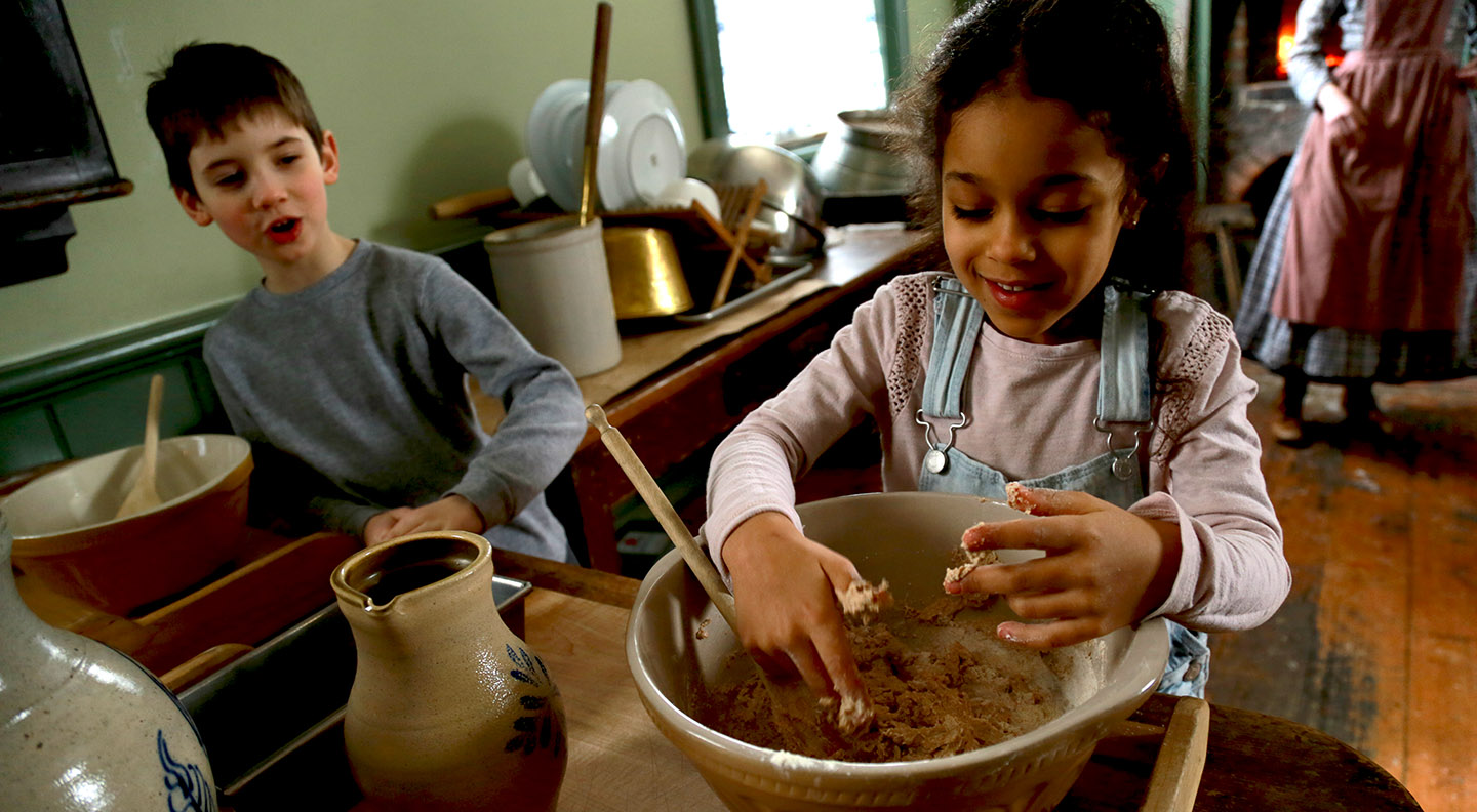 students try their hands at baking in a kitchen at Black Creek Pioneer Village