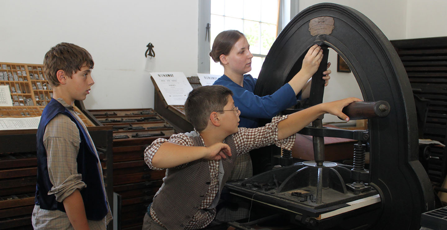 young apprentices at work in the Printing Office at Black Creek Pioneer Village