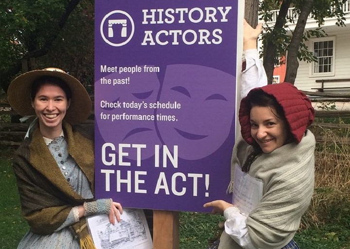 History Actors pose beside History Actors sign