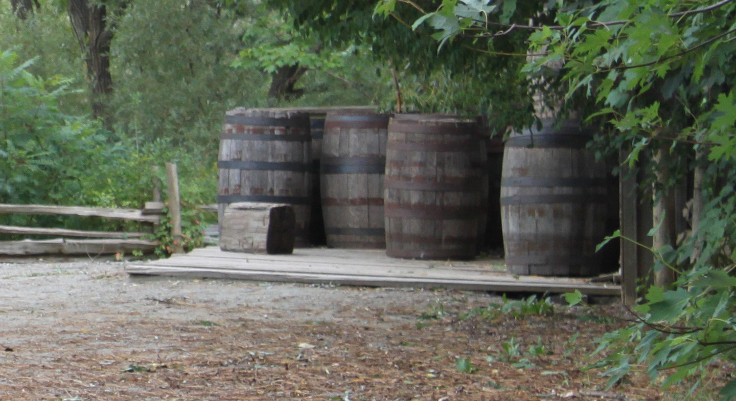 barrels stand outside Roblins Mill at Black Creek Pioneer Village