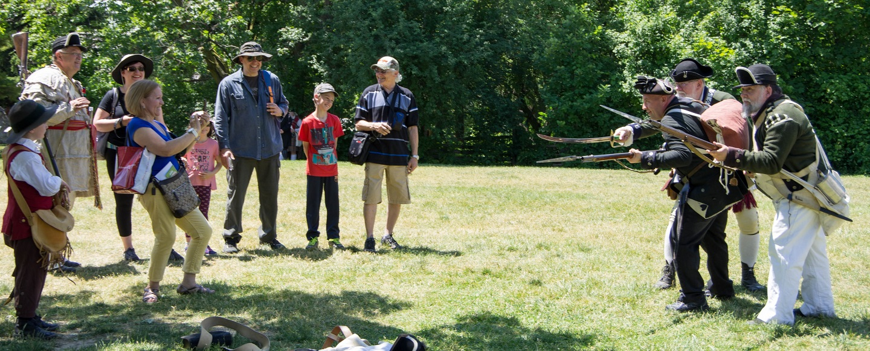 park visitor photographs Revolutionary War re-enactors at the annual Battle of Black Creek event