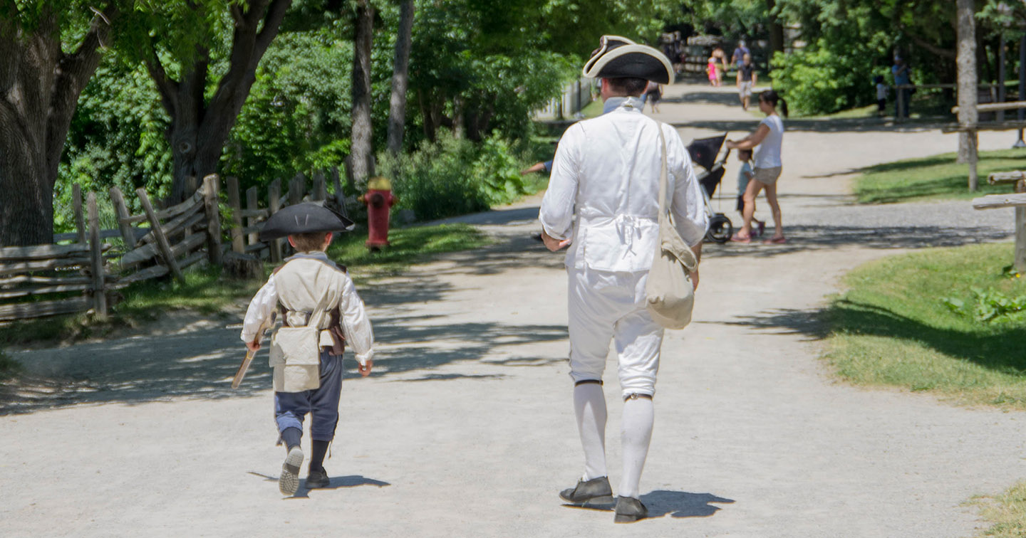 a man and a young boy in Revolutionary War uniform during the Battle of Black Creek event