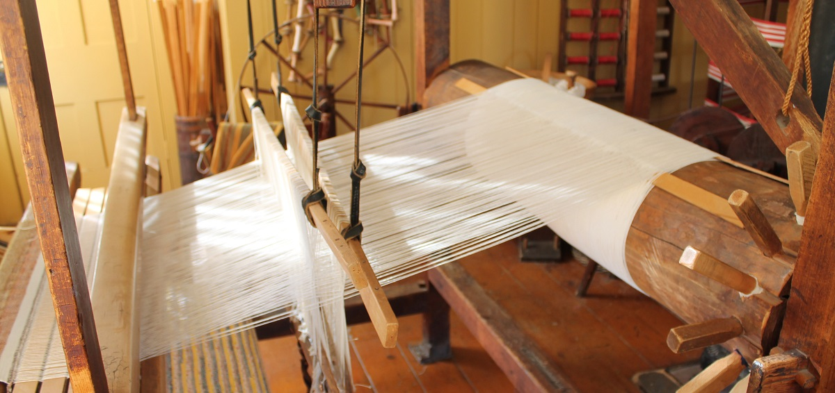 a loom at the Charles Irvine Weaver Shop at Black Creek Pioneer Village