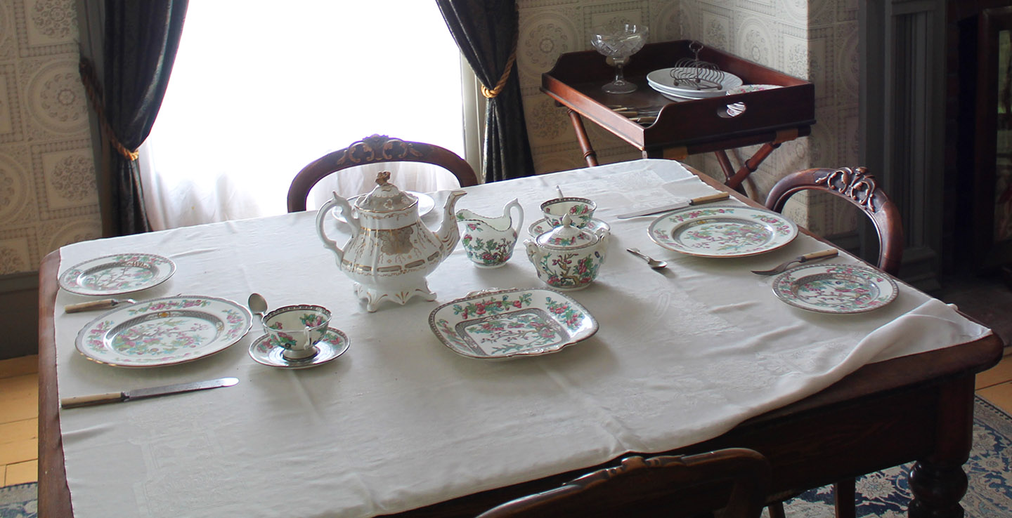 table set with fine china at Black Creek Pioneer Village Doctors House