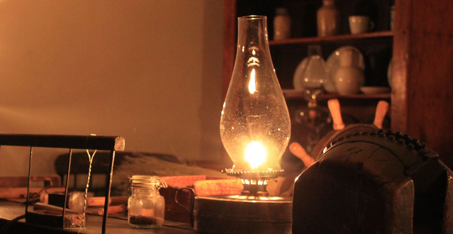 a kerosene lamp lights up a room at Black Creek Pioneer Village