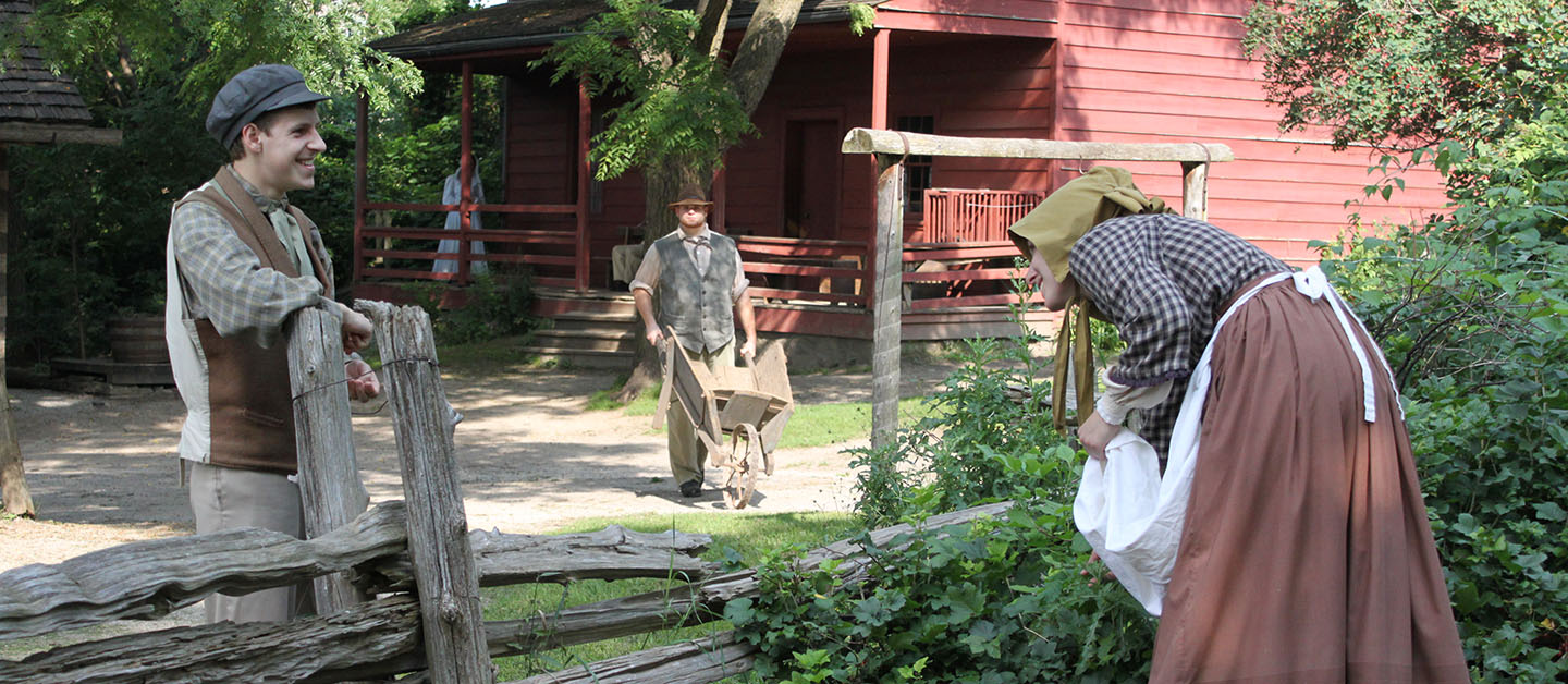 interpreters in period costume re-enact pioneer life
