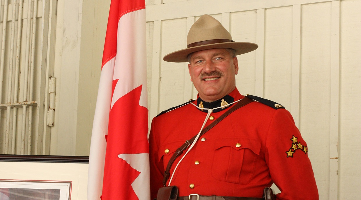 a Mountie stands on guard at the Black Creek Pioneer Village Canada Day celebration
