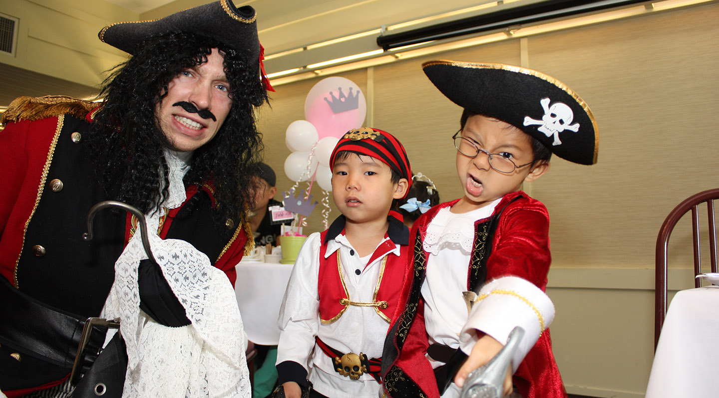 history actor poses with youngsters at Black Creek Pioneer Village Pirates and Princesses event
