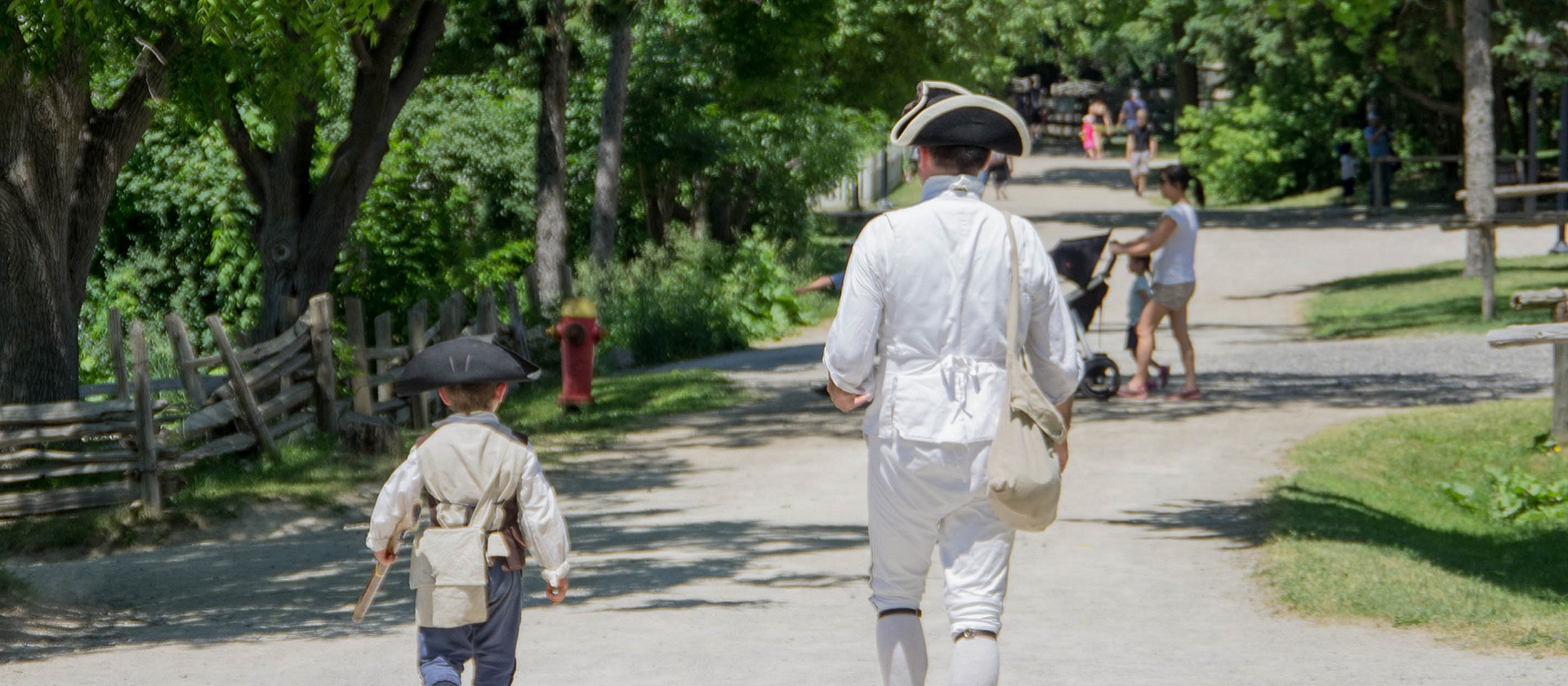 man and boy dressed as Colonial soldiers at the Battle of Black Creek Event