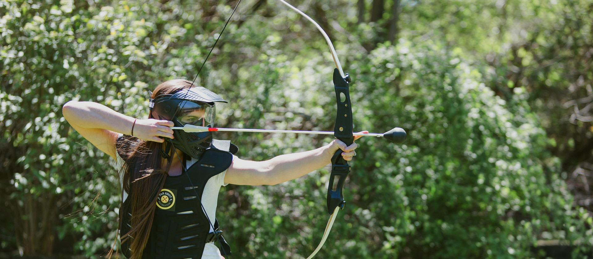 young woman in armour plays archery dodgeball