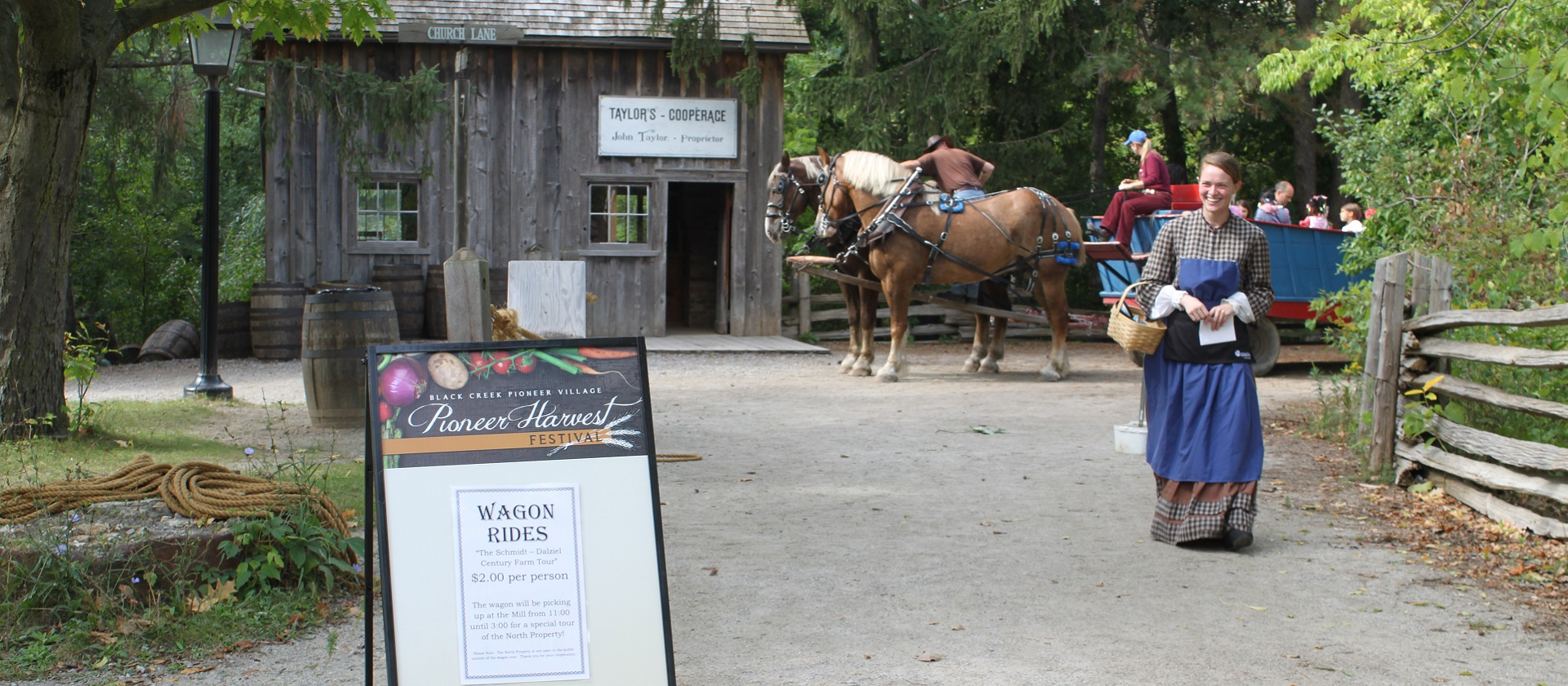 visitors to Black Creek Pioneer Village enjoy a horse drawn wagon ride during the Pioneer Harvest Festival