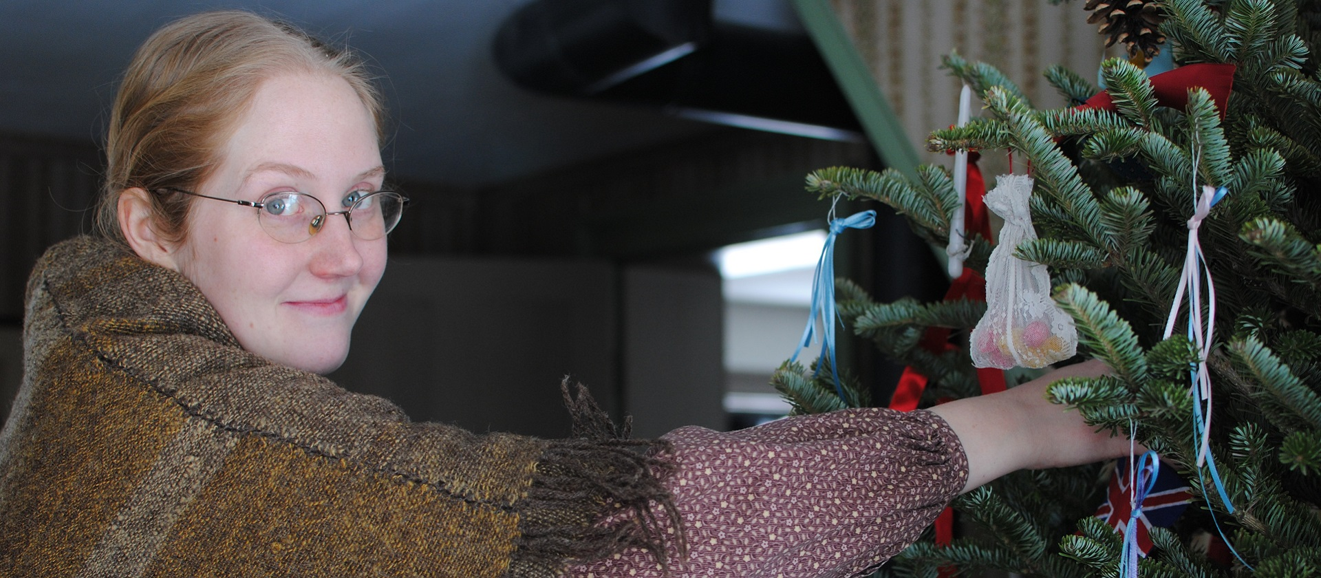 history actor at Black Creek Pioneer Village decorates Christmas Tree