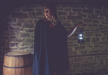 robed woman with lantern leads haunted walk at Black Creek