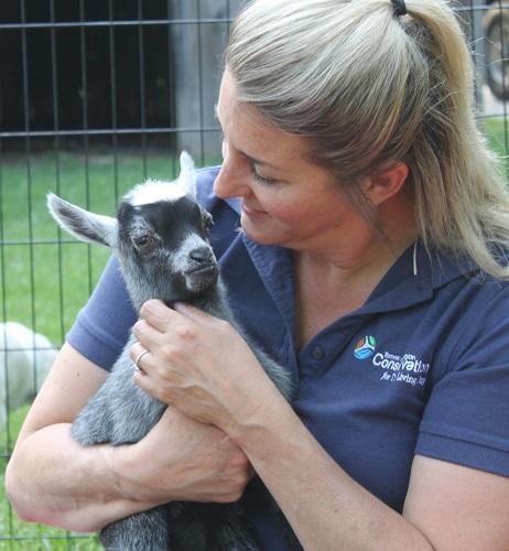 Elizabeth Oakley holds baby goat