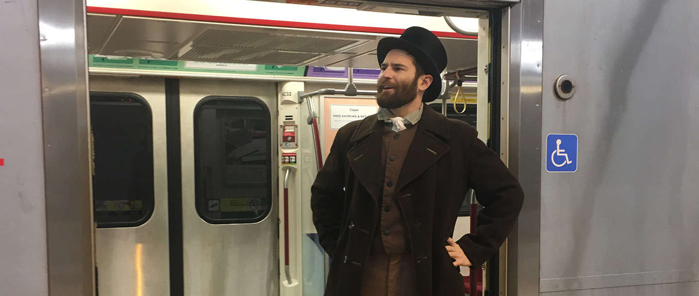 history actor in period costume at Pioneer Village subway station