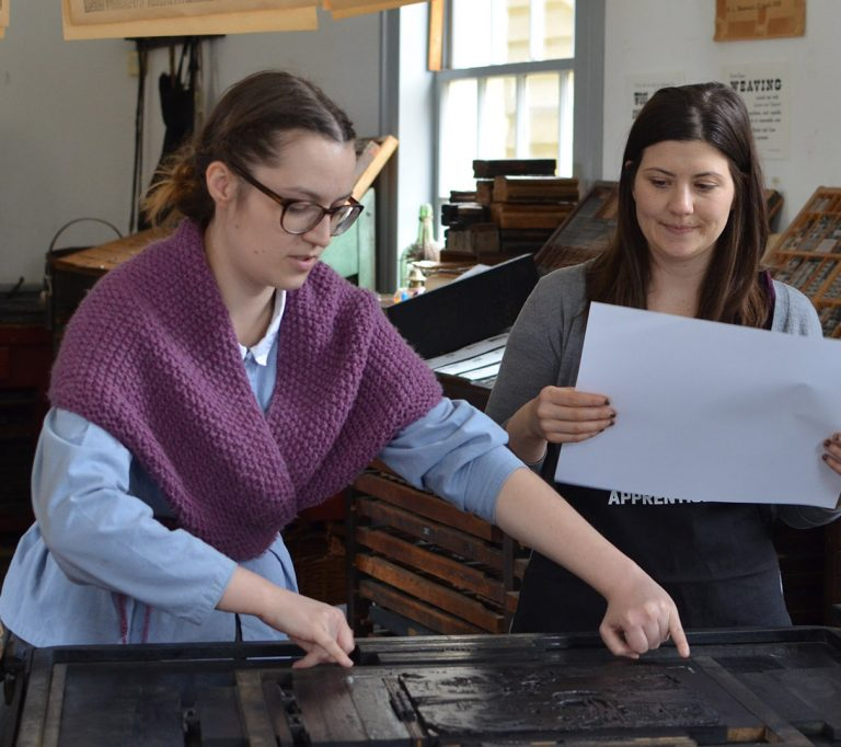 young woman works as apprentice in Black Creek printing office