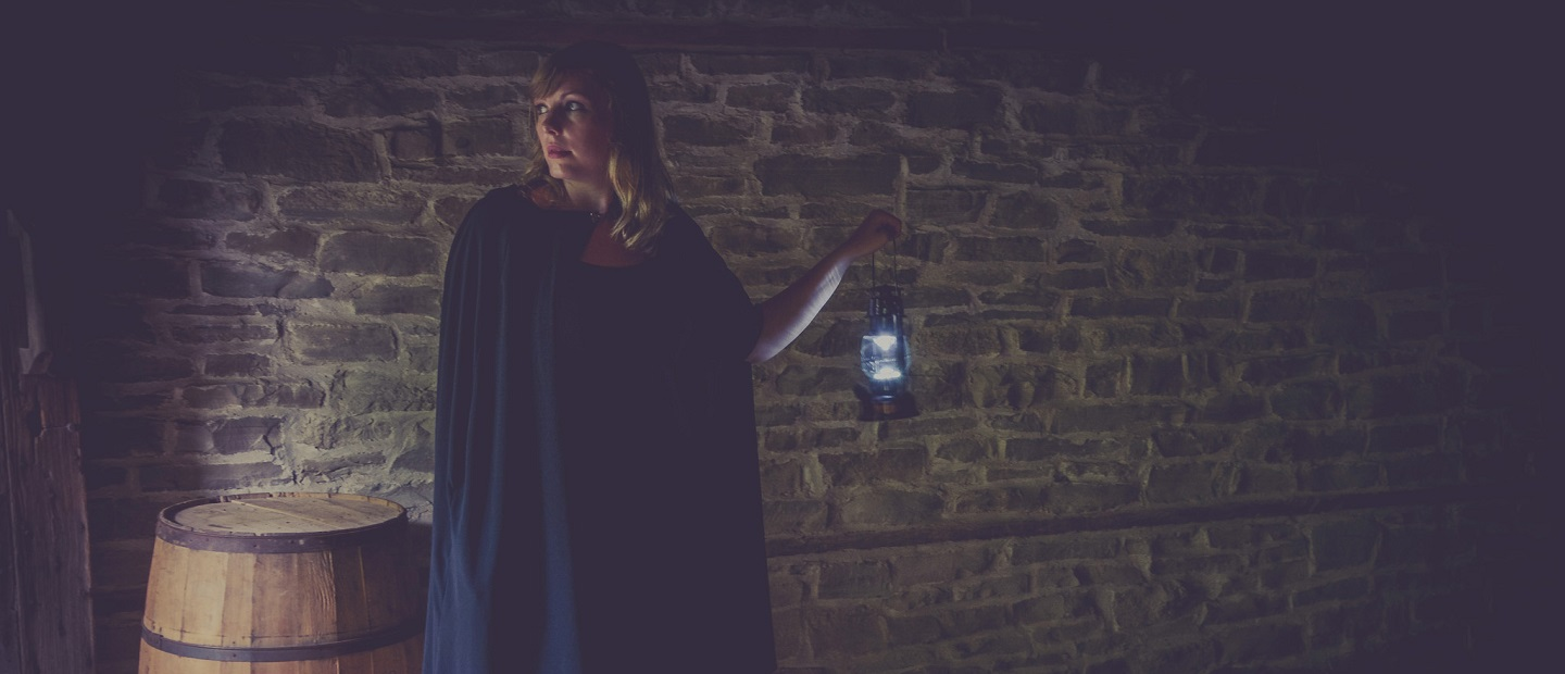 guide with lantern leads Haunted Walk at Black Creek Pioneer Village